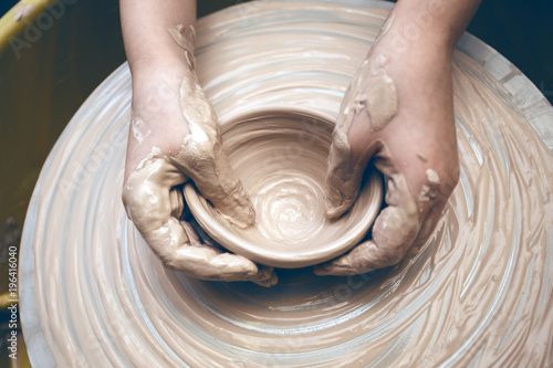 ceramic workshop - the girl makes a pot of clay