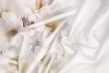 White  Crumpled Wrinkled Fabric With Waves And Large White Flowers, Daisies, Background Crumpled Tissue,  Double Exposure Photo .
