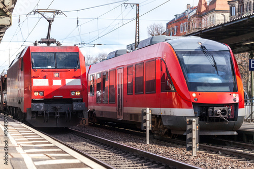 a german train passes a train station