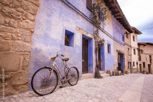 Tuinposter Mexico Valderrobres, Spain - March 10, 2018: Old bicycle in the street, from Valderrobres a village in the Matarranya district is one of the most beautiful cities of Teruel in Spain