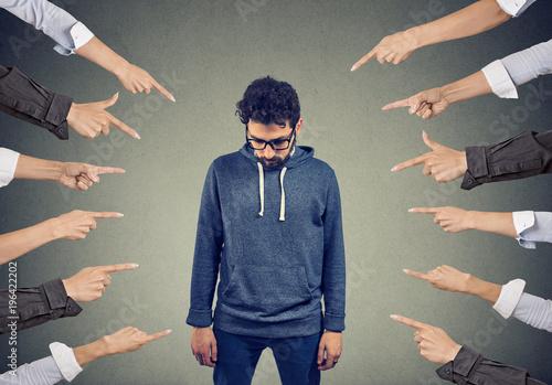 Photo Bullied man. Public accusation concept