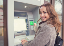 Young Happy Woman Using ATM