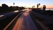 Time lapse - cars travel on a freeway at sunset or dusk.