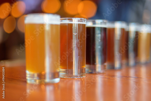 Low angle close up of beer flight lined up on the table фототапет