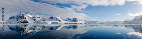 Photo Stands Antarctica Iceberg reflections on calm water in the Paradise Bay of Antarctica.