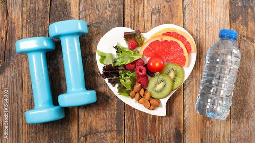 Fototapeta healthy eating and dumbbell obraz na płótnie