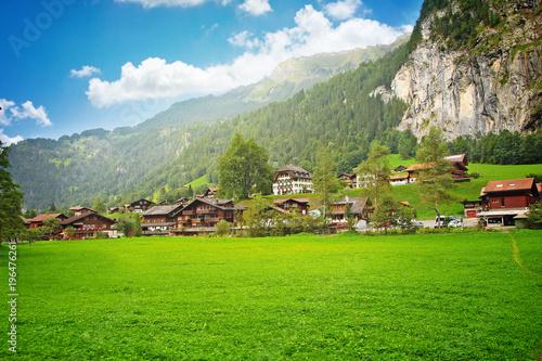 Fotobehang Olijf European beautiful village in the Alps, Switzerland, landscape with wooden houses