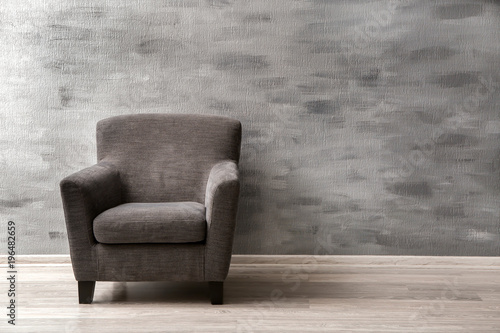 Fotografie, Obraz  Comfortable armchair near grey wall indoors