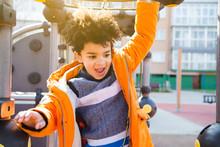 Happy Little Boy Having Fun In The Playground