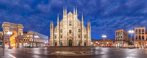 fototapeta na ścianę Panoramic view of piazza del Duomo, Cathedral Square, with Milan Cathedral or Duomo di Milano, Galleria Vittorio Emanuele II and Arengario, during morning blue hour, Milan, Lombardia, Italy
