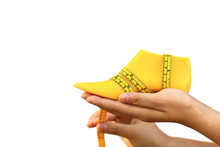 Woman Hand Holding Yellow Plastic Last Shoe And Measuring Tape On White Background