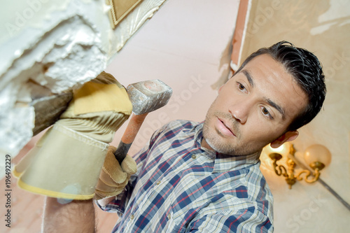 Chiselling off plaster Canvas-taulu