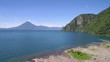 Aerial over Lake Amatitlan in Guatemala reveals the Pacaya Volcano in the distance.