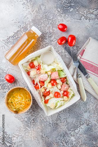 Foto op Aluminium Assortiment Caesar salad with salmon