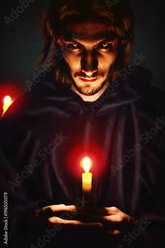 Fototapeta evil sorcerer with a candle