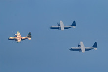 Israeli Fighter Jet And Tanker In Air Refueling. The Jets Flight From Right To Left In Formation.