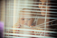 Baby Son And Mother Open Blinds
