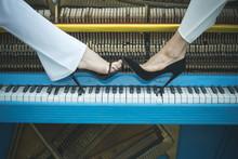 Legs On Piano Keyboard Blue Co...