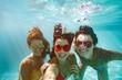 canvas print picture - Cheerful friends making selfie underwater in pool