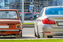 Rear View Of Two Cars Of Diffe...