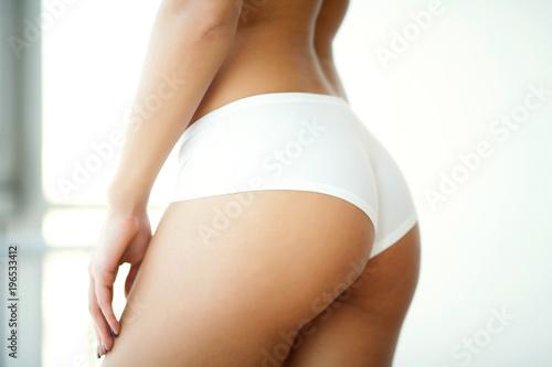 Valokuva Closeup Of Beautiful Slim Woman Body With Sexy Buttocks, Big Ass