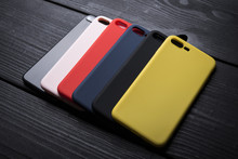 Mobile Multicolored Phone Covers Or Phone Cases On Black Wooden Background