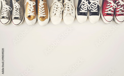 Colourful sneakers on white background