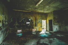 Inside Of An Abandoned And Condemned Building With Graffiti