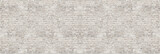 Fototapeta Młodzieżowe - Vintage white wash brick wall texture for design. Panoramic background for your text or image.