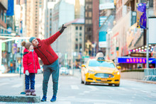 Family Of Father And Little Kid On Times Square During Their Vacation In New York City