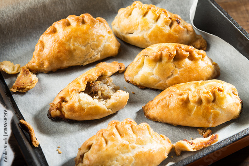 Hot pasties from butter enriched puff pastry filled with minced beef, potato, on Tapéta, Fotótapéta