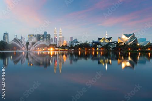 Photo Stands Kuala Lumpur Cityscape. image of Kuala Lumpur, Malaysia during sunset at Titiwangsa park with fountain.