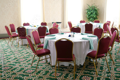 dinner tables and chairs in the banquet hall Wallpaper Mural
