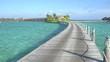 Walking down the wooden jetty towards luxurious ocean villas