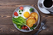 Fried eggs, croutons and salad with coffee and orange juice.