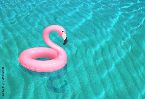 Valokuva Inflatable pink flamingo floating on the sea surface