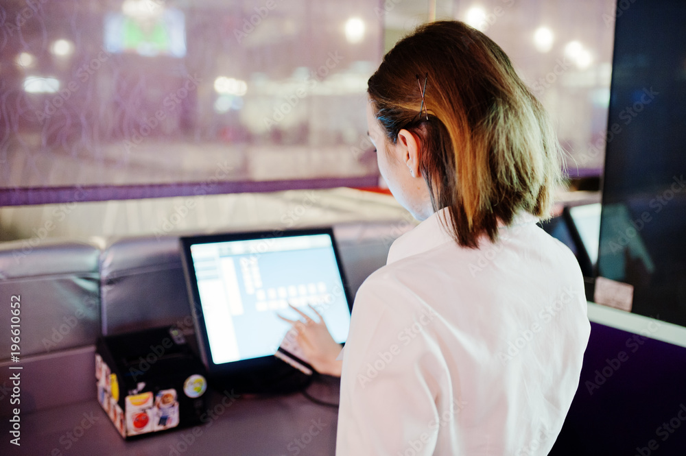 Fototapeta Waiter girl working with pos terminal or cashbox at cafe. People and service concept