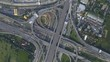 Aerial view of highway road interchange with busy urban traffic speeding on the road, taken by drone. The city highway was taken at eastern Bangkok outer ring road, junction network of transportation.