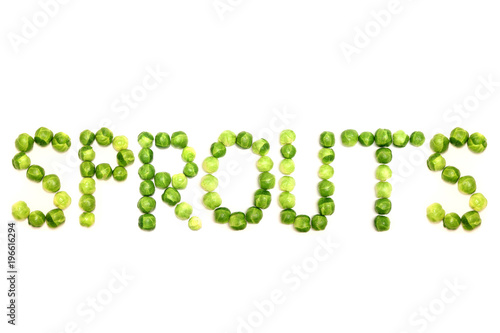 The word 'sprouts' is spelled out with brussel sprouts on a white Image and coul Canvas Print