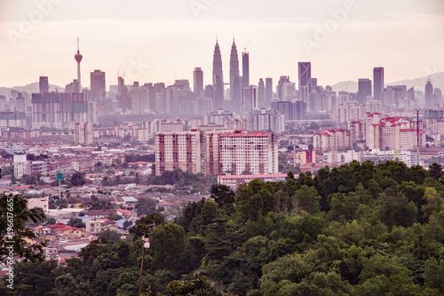 Skyline of Kuala Lumpur using Valencia filter to give retro insta feel, shows ic Poster