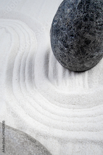 Foto op Canvas Stenen in het Zand Zen garden stone with curves on sand