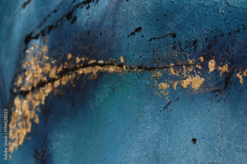 Blue painting acrylic with metal flakes. Drops, lines, arrows close up