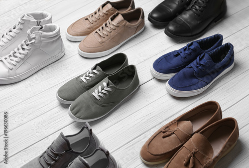 Different male shoes on light background