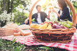 canvas print picture - Couple in love drink a orange juice and fruits on summer picnic, leisure, holidays, eating, people and relaxation concept