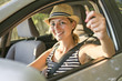 woman sitting in a rental car on holiday vacancy