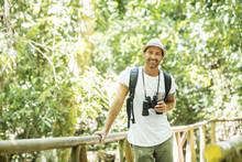 Tourists Man With Binoculars L...