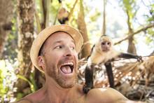 Men Tourist Makes Selfie Self Portrait With Monkey