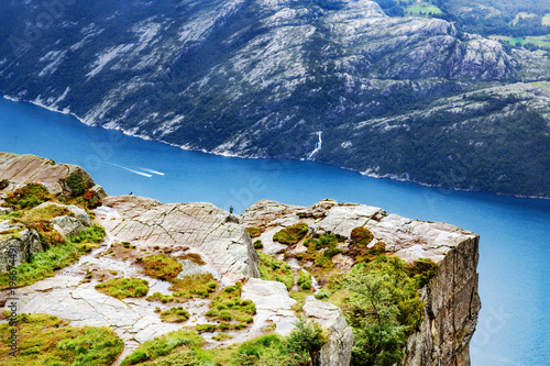Staande foto Nachtblauw Norway, Scandinavia, Europe. Spectacular view on Lysefjord and Norwegian iconic landmark Preikestolen pulpit rock. Traditional northern Norwegian nature landscape. Travel to Scandinavia background.