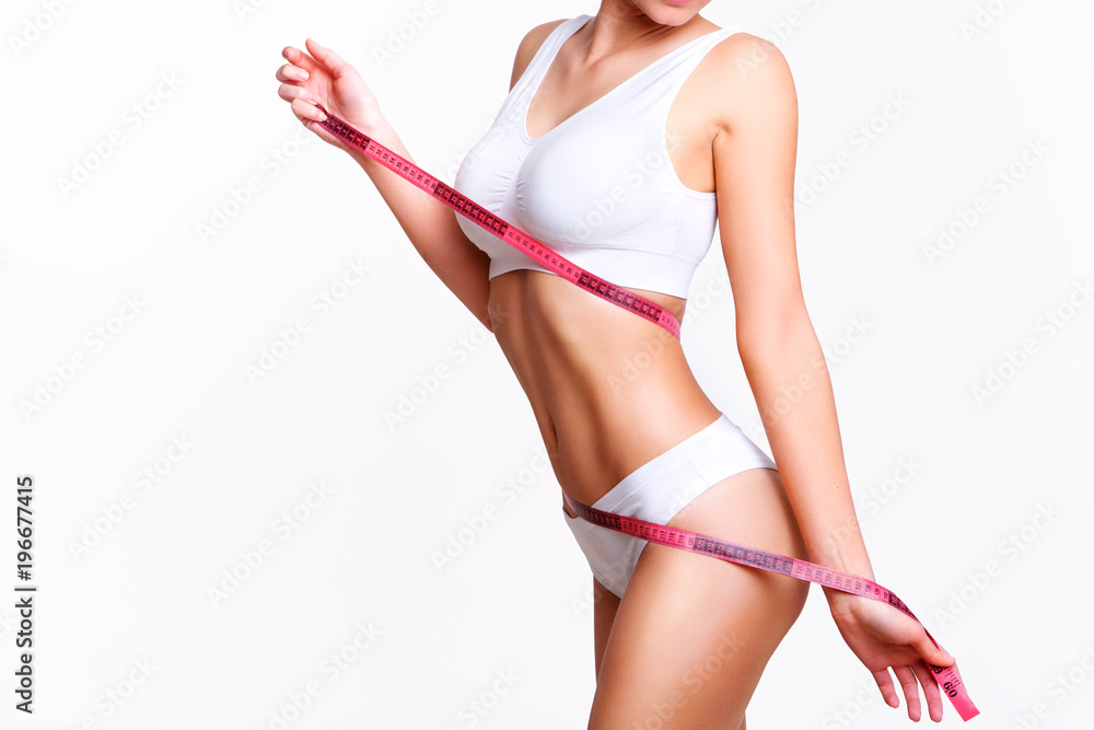 Fototapeta Woman beauty, body care. Slender line of a beauty young body in underwear.
