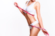 Woman beauty, body care. Slender line of a beauty young body in underwear.